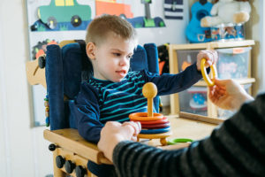 kid with cerebral palsy playing